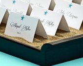 Scallop Seashell Beach Wedding Escort Cards or Place Cards  in Coral set of 50. $62.50, via Etsy.