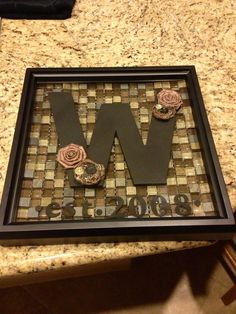 Letters on tile again. Best housewarming gift ever. Made some fabric flowers and bought some.
