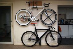 Elevated wall mounted bike rack. I need something like this for my new apartment, for my and my roommate's bike.