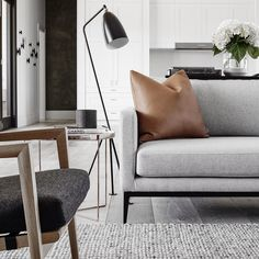 @griffiths.design.studio. Photo by @blachford. Rug by @halcyonlake. Sofa by @zusterfurniture. Leather cushion by @jardanfurniture. Floor lamp by @gubiofficial. Armchair by @stylecraftfurniture.