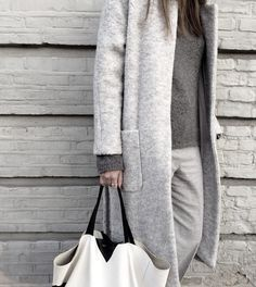 Can't get enough of these oversized coats and knits. #streetstyle #winterstyle