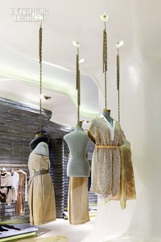 Ports 1961's boutique in Shanghai designed by Archi-Tectonics - #chain supported #mannequins #retail #retaildesign