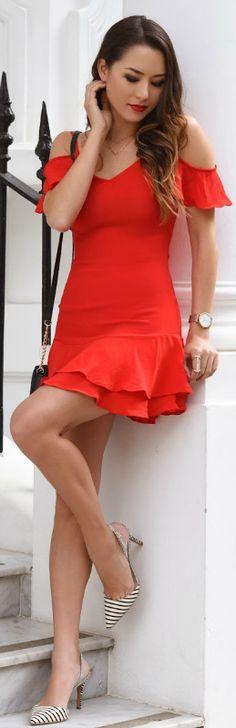 Jessica R. + ultra sexy + playful red mini dress + ruffle sleeve + skirt detailing + statement heels + striped stilettos + Jessica's look  Dress: Lulus.