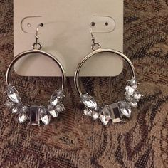 NWT's Stunning silver tone/ clear stones earrings NWT's Stunning silver tone statement earrings with clear stones. Jewelry Earrings