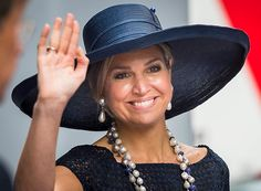 HMS Koningsdam, the newest and largest ship in Holland America's cruise fleet, was officially christened today in Rotterdam by Queen Máxima, who used the occasion to début a new hat. In navy …