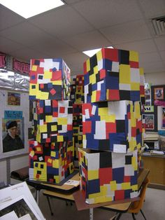 Mondrian Collaboration. Each table gets a cardboard box. I will pre cut the squares in yellow, red, black, white, and blue paper. The students will then take art paste (water and glue) and paint the squares on the box. The boxes will go out in the hallway as a big sculpture.