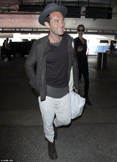 Jetset: Jude Law was looking handsome as ever as he arrived at LAX airport alongside his girlfriend Phillipa Coan on Friday