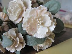 Carnations made of Kitten's Paw Shells