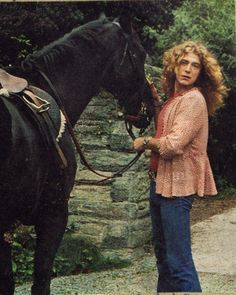 Robert Plant making friends with a horse!