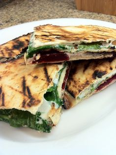 Grilled quesadilla with beets, goat cheese, spinach, and fresh mozzarella.
