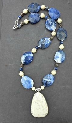 Measuring 26 inches long and can be sized up with notes to seller at checkout. With silver metal, Sodalite gemstone, white howlite, jasper stones. The stones are raw cut so they are not 100% smooth an