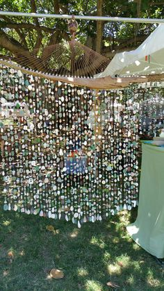 Driftwood sea glass shell mobile from a local artist in Waikiki beach Hawaii, summer She uses a Dremel to drill holes in the sea glass, shells and rocks. Seashell Mobile, Driftwood Mobile, Driftwood Wall Art, Driftwood Crafts, Seashell Crafts, Beach Crafts, Sea Glass Crafts, Sea Glass Art, Shell Wind Chimes