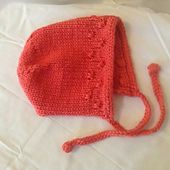 This is a simple bonnet pattern that could be used for a boy or girl. There is instructions to add a ribbed back band to give the bonnet a tighter fit.