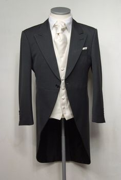 "Charcoal grey herringbone grooms morning suit. Choose from our wide range of wedding waistcoat's in a variety of styles. Mens sizes from 32"" chest upward and include extra short, short, regular, long and extra long fittings. Boys sizes from 20"" chest to 34"" chest. Complete outfit includes jacket, trousers, hire or matching waistcoat, brand new traditional or French wing shirt in white or ivory, tie or cravat, braces and cufflinks. £125.00 to hire #groom #wedding #suit #suithire #waistcoat…"