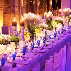 Lemon centerpieces to brighten the night! FANYC. #lemons #tablesetting #weddings #bride #nycweddings #weddingflowers