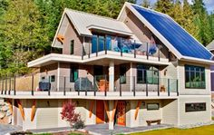A stylish home built from sustainable materials with see thru solar panels.