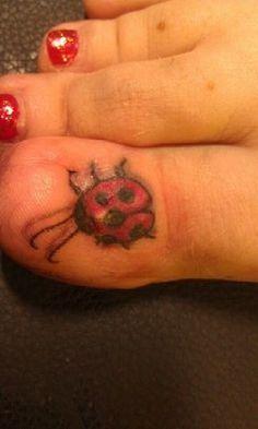 flower tattoo big toe