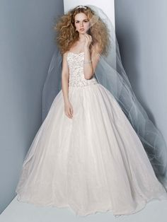 Stunningly dramatic this magnificent organza wedding dress is the perfect choice for any bride wanting to feel like a Princess! Oleg Cassini Style CT569 #davidsbridal #weddingdress #aislestyle Enter the Aisle Style Sweeps for a chance to win up to $3,000 in gift certificates from David's Bridal & Helzberg Diamonds! Enter now thru 9/2: http://sweeps.piqora.com/aislestyle Rules: http://sweeps.piqora.com/contests/contest/content/davidsbridal.com/310/rules