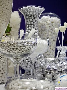 White Candy Buffet White taffy, silver chocolate balls, giant jawbreakers, white rock candy, white champagne bubble gumdrops, white mints, and shiney silver hearts are featured in this exquisite candy buffet.