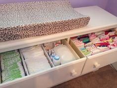 Dresser as changing table with great organization in drawers.