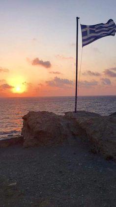 The Greek flag at sunset in Karpathos (photo by Marigo Mihalos) Mykonos Greece, Santorini, Beautiful Islands, Beautiful Places, Greece Flag, Greek Soldier, Karpathos, Places To Go, The Places Youll Go