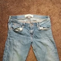 Damaged Hollister Jeans Damaged hems, and stretch by pockets. See pictures. No holes or stains other than what's pictured. Marked accordingly.  98% cotton 2% elastane  W28 and L33 I think they are straight leg but maybe boot cut. Hollister Jeans Straight Leg