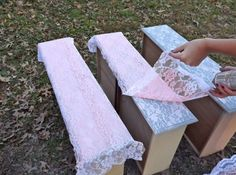 Spray painting over lace to get vintage look on wooden furnishings.