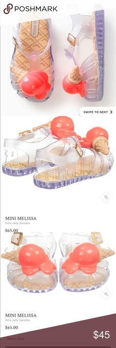Mini- Melissa ice cream cone sandal Pictures of the actual show to follow   Designed by Mini Melissa for girls, these clear jelly sandals have an ice-cream decoration across the toes. Made in sweet-smelling and soft rubber, they have a buckle fastening, a cushioned inner sole and non-slip rubber outer sole. Product number 186739 Made from super-soft Melflex plastic New varnish finishing technology means shoes are easy to clean with just a cloth & warm water Style name: Mini Aranha Ice-Cream…