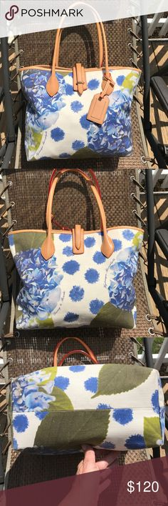 """Authentic Dooney & Bourke Hydrangea Flower Tote Authentic Dooney & Bourke Hydrangea Flower Tote.  The fabric is in beautiful condition. The leather which has been filmed has stains on it from storage. Aging and wearing the bag will help. Inside the bag from first appearance looks great. On the corner it does have pen(filmed) also along front wall. This bag is being reduced in price for these flaws. Measurements appropriately 10 1/4"""" H x 11 1/4"""" w x 5 3/8"""" D 8 1/4"""" strap drop. 🚫trades…"""