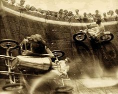 A lion riding in the sidecar of a go-kart at local circus carnival attraction Revere Beach circa 1929