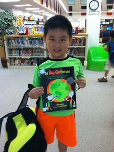 """""""Earlier this month intermediate students were introduced to the newest Rebecca Caudill and Bluestem award books by Mrs. Domek, LMC Director. A popular Bluestem book, The Day-Glo Brothers by Chris Barton, was especially liked by Julian P. Julian just happened to be wearing Day-Glo colors the day the book was introduced!"""" Chris Barton, More, Brother, Students, Neon, Popular, Shit Happens, Colors, How To Wear"""