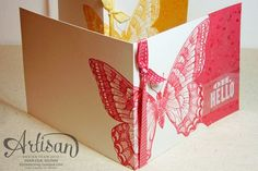 """By Marisa Gunn. Stamp Swallowtail across middle of card before scoring. Trim along right edge of butterfly. Cut matching solid cardstock piece 5 1/23"""" x 4 1/4."""" Stamp with a splatter stamp in ink the same color as cardstock. Spray with vanilla shimmer smooch spritz then drip some of it onto cardstock. Stamp sentiment on vellum with white StazOn ink. Assemble. Add ribbon."""