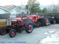 Not all old tractors get to live in the barn. Here is the old tractors along the fence.  A working IHC Farmall Cub, an antique Case tractor or two, an old Cab for parts in the back, etc.