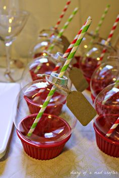 Ornament drinking glasses - serve it sitting in a plastic ramekin ( found at the Dollar Store) so your guests can set it down!  These are SO FESTIVE!