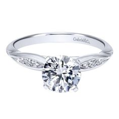 14k white gold .85cttw bead set pinched round diamond engagement ring. This .10cttw mounting features a row bead set round side diamonds with a pinch, accenting a .75ct round center diamond. Price inc