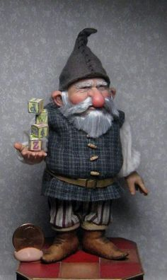 This big nosed Santa's elf resides with two others from Sharon in my funny and whimsical Santa's workshop! Louise Glass