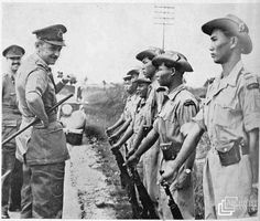 The High Commissioner in Malaya Congratulates Another Home Guard Unit in Malaya: Sir Gerald Templer and his assistant, Major Lord Wynford (extreme left) are seen with members of Kinta Valley Home Guard. On the right of this picture is Wong Fook Seng, the commander of the unit. Sir Gerald congratulated the men for the part they played in capturing Communist terrorists. Malayan Emergency, Home Guard, Rubber Raincoats, Templer, Guerrilla, British Army, Cold War, Military History, Armed Forces