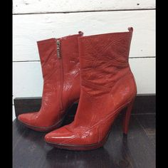 Carlos Santana patent leather ankle boots Smokin' hot for the holidays these are I great condition and as high as they are, are really comfortable! A true to size 7 1/2. Very striking :) Carlos Santana Shoes Heeled Boots