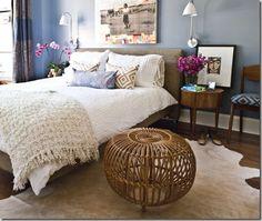 cowhide rug and rattan ottoman
