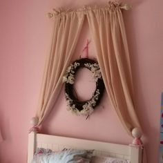 Faux canopy I did on Belle's bed.  Very easy to do.  Use a short curtain rod at the top.