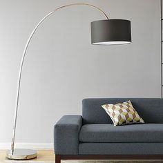 Overarching Floor Lamp #WestElm  Can help marry the modern with the traditional & pulls in the gray from the Strandmon chairs