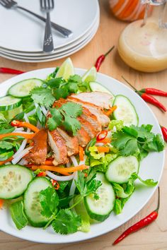 Banh Mi Chicken Salad (inspired by the flavours on Vietnamese banh mi sandwiches with chicken in a Vietnamese caramel sauce, lettuce, cucumber, pickled carrots and radish and a tasty dressing)