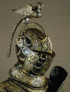 RENAISSANCE ARMOUR 16TH Piccinino,Lucio,armourer Helmet with harpy (Greek harbinger of pain and famine), from the armour of Alessandro Farnese (1545-1592), famous general of King Philip II of Spain and governor of the Netherlands. 1578. See 17-01-02/1-28. Milan workshop, bluesteel, gold and silver, Inv. A 1132 Kunsthistorisches Museum, Ruestkammer, Vienna, Austria
