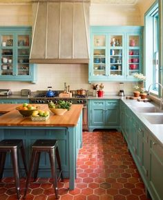 Vibrant turquoise and terracotta in this expansive kitchen in a Greenwich Village townhouse by Sawyer Berson.