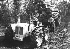 Fordson pullin out a load of logs
