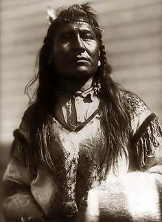 You are looking at an intriguing picture of New Chest, an Indian Man. It was taken in 1910 by Edward S. Curtis.    The picture presents New Chest in a half-length portrait, facing forward.    We have created this collection of pictures primarily to serve as an easy to access educational tool. Contact curator@old-picture.com.