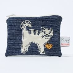Our range of small and large useful embroidered purses are a really lovely way of taking home a little piece of classic Poppy Treffry embroidery.These are individually stitched with a cute motif of a sweet little cat.Made from quality denim and cotton tic Freehand Machine Embroidery, Free Motion Embroidery, Embroidery Ideas, Hand Embroidery, Cat Themed Gifts, Sewing Art, Sewing Ideas, Christmas Cats, Zipper Bags