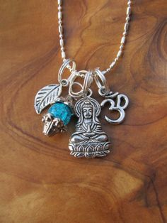 """to enhance good luck and wealth and is also a symbol of wisdom and compassion. Om is the Sanskrit letter or symbol for the sacred Hindu sound om, which blesses people with luck, material comforts and spiritual powers.     Comes on a nice quality 19-1/2 inch sterling-plated ball/bar chain with 2"""" extender and lobster claw clasp!    Thanks for looking and Namaste :)  ♥Destiny    $18.00"""