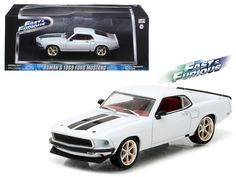 """Roman's 1969 Ford Mustang Custom """"Anvil Halo"""" Fast and Furious 6 Movie (2013 ) 1/43 Diecast Model Car by Greenlight - Brand new 1:43 scale diecast car model of Roman's 1969 Ford Mustang Custom """"Anvil Halo"""" Fast and Furious 6 Movie (2013 ) die cast car model by Greenlight. Rubber tires. Brand new box. Limited Edition. Detailed interior, exterior. Comes in plastic display showcase. Dimensions approximately L-5 inches long.-Weight: 1. Height: 5. Width: 9. Box Weight: 1. Box Width: 9. Box…"""
