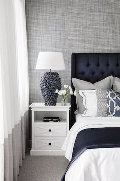 Hamptons bedroom decor with blue head board on bed in the Boston 36 display home by Clarendon Homes